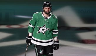 FILE - Dallas Stars right wing Alexander Radulov (47) skates onto the ice during team introductions before an NHL hockey game against the Nashville Predators in Dallas, in this Friday, Jan. 22, 2021, file photo. High-scoring Dallas Stars forward Alexander Radulov will not return this season because he needs surgery to repair a core muscle injury. Stars general manager Jim Nill said Wednesday, April 14, 2021, that Radulov is expected to be fully recovered for the 2021-22 season. (AP Photo/Tony Gutierrez, File)