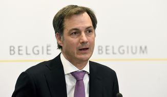 Belgian Prime Minister Alexander De Croo speaks during a media conference, after a meeting with federal and regional officials regarding COVID-19 measures, in Brussels, Wednesday, April 14, 2021. (Frederic Sierakowski, Pool via AP)