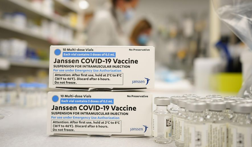 In this March 6, 2021, file photo, boxes stand next vials of Johnson & Johnson COVID-19 vaccine in the pharmacy of National Jewish Hospital for distribution in east Denver. (AP Photo/David Zalubowski, File)  **FILE**