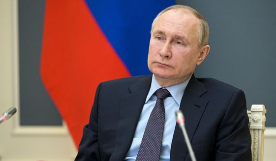 Russian President Vladimir Putin attends a session of the Russian Geographical Society via video link in Moscow, Russia, Wednesday, April 14, 2021. (Alexei Druzhinin, Sputnik, Kremlin Pool Photo via AP)