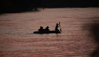 Some smugglers use inflatable rafts to take families across the Rio Grande from Mexico to the U.S. Authorities in Texas have reported an increase in drownings in the river this year. (Associated Press)