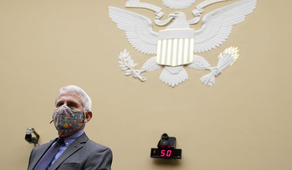 Dr. Anthony Fauci, the nation's top infectious disease expert, waits for the start of a House Select Subcommittee on the Coronavirus Crisis hearing on Capitol Hill in Washington, Thursday, April 15, 2021. (AP Photo/Susan Walsh, Pool)