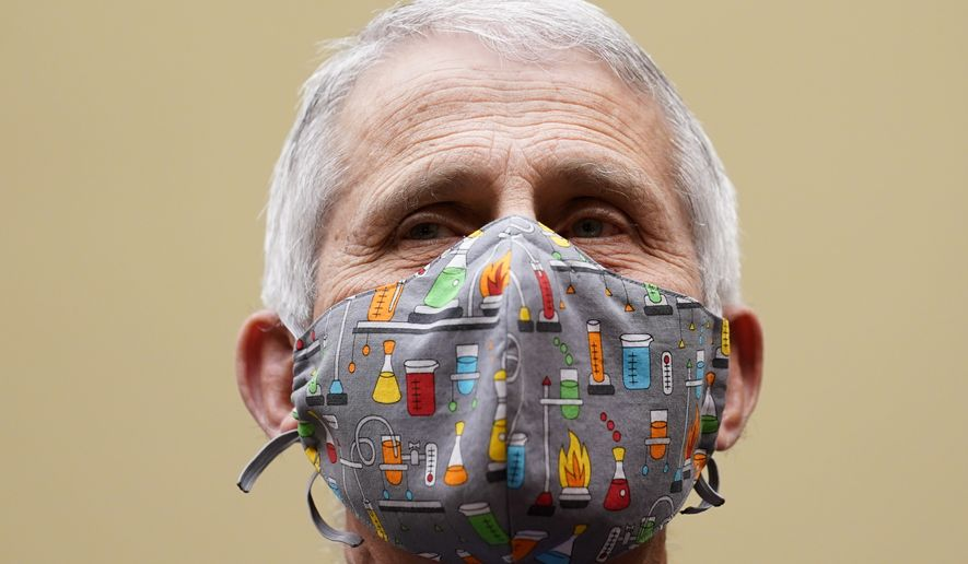 Dr. Anthony Fauci, the nation's top infectious disease expert testifies before a House Select Subcommittee on the Coronavirus Crisis hearing on Capitol Hill in Washington, Thursday, April 15, 2021. (AP Photo/Susan Walsh, Pool)