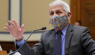 Dr. Anthony Fauci, the nation's top infectious disease expert, responds to a question from Rep. Jim Jordan, R-Ohio, during a House Select Subcommittee hearing on Capitol Hill in Washington, Thursday, April 15, 2021, on the coronavirus crisis. (AP Photo/Susan Walsh, Pool)