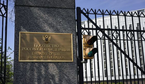 The entrance gate of the Embassy of the Russian Federation is seen in Washington, Thursday, April 15, 2021. The Biden administration has rolled out a sweeping set of sanctions on Russia over its election interference, hacking efforts and other malign activity. (AP Photo/Carolyn Kaster)