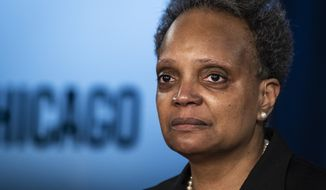 Mayor Lori Lightfoot discusses the videos of 13-year-old Adam Toledo, who was fatally shot by a Chicago police officer, during a news conference at City Hall, Thursday, April 15, 2021. Lightfoot urged the public to remain peaceful and reserve judgement until an independent board can complete its investigation into the police shooting of Toledo last month. (Ashlee Rezin Garcia/Chicago Sun-Times via AP)