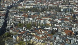 FILE - In this Thursday, April 4, 2019, file photo, apartment buildings in the district Mitte photographed from the television tower in Berlin, Germany. Germany's highest court has ruled that a cap on rent prices implemented last year by Berlin's left-wing state government is unconstitutional and void. (AP Photo/Markus Schreiber, file)