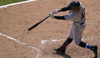 Cleveland Indians' Jose Ramirez hits a two-run home run during the sixth inning of a baseball game against the Chicago White Sox in Chicago, Thursday, April 15, 2021. (AP Photo/Nam Y. Huh)