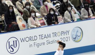 USA's Nathan Chen performs during the men's short program of the ISU World Team Trophy figure skating competition in Osaka, western Japan, Thursday, April 15, 2021. (AP Photo/Hiro Komae)