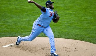 Minnesota Twins pitcher Michael Pineda throws against the Boston Red Sox during the first inning of a baseball game, Thursday, April 15, 2021, in Minneapolis. (AP Photo/Craig Lassig)