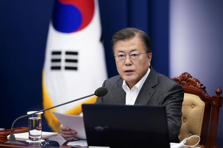 South Korean President Moon Jae-in speaks during a meeting of his senior secretaries at the presidential Blue House in Seoul, South Korea, Monday, April 12, 2021. Moon on Monday welcomed a decision by two South Korean electric vehicle battery makers to settle a long-running intellectual property dispute that had threatened thousands of American jobs and President Joe Biden's environmental policies. (Choe Jae-koo/Yonhap via AP)