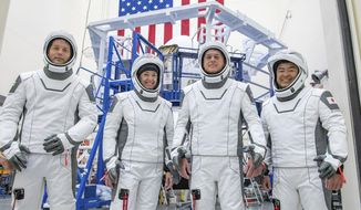 This undated photo made available by SpaceX in April 2021 shows the crew for its third astronaut launch to the International Space Station, during a training session at the SpaceX training facility in Hawthorne, Calif. From left are mission specialist Thomas Pesquet of the European Space Agency, pilot Megan McArthur and commander Shane Kimbrough of NASA, and mission specialist Akihiko Hoshide of the Japan Aerospace Exploration Agency. (SpaceX via AP)
