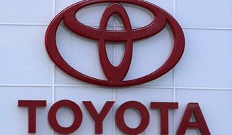 This Aug. 15, 2019 file photo shows the Toyota logo on a dealership in Manchester, N.H. Toyota is recalling nearly 280,000 Venza SUVs in the U.S., Thursday, April 15, 2021,  because a wiring problem could stop the side air bags from inflating in a crash. The recall covers Venzas from the 2009 through 2015 model years.   (AP Photo/Charles Krupa, File)
