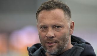 Berlin's coach Pal Dardai arrives for the German Bundesliga soccer match between Hertha BSC Berlin and Borussia Moenchengladbach at the Olympic stadium in Berlin, Germany, Saturday, April 10, 2021. Hertha Berlin coach Pal Dardai has tested positive for the coronavirus along with one of his assistants and forward Dodi Lukebakio. (Soeren Stache/Pool via AP)