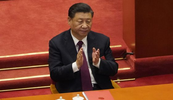 In this file photo dated Thursday, March 11, 2021, Chinese President Xi Jinping applauds during the closing session of the National People's Congress in Beijing. (AP Photo/Sam McNeil, File)