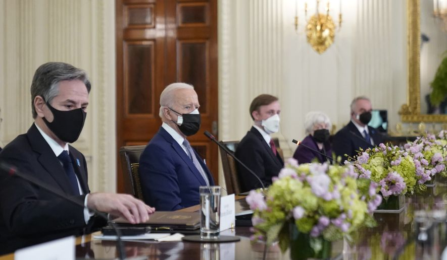 President Joe Biden listens as he meets with Japanese Prime Minister Yoshihide Suga in the State Dining Room of the White House, Friday, April 16, 2021, in Washington. Others are Secretary of State Antony Blinken, from left, national security adviser Jake Sullivan, Treasury Secretary Janet Yellen and Kurt Campbell, coordinator for the Indo-Pacific on the National Security Council. (AP Photo/Andrew Harnik)