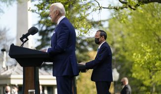 Japanese Prime Minister Yoshihide Suga, listen as President Joe Biden speaks at a news conference in the Rose Garden of the White House, Friday, April 16, 2021, in Washington. (AP Photo/Andrew Harnik)