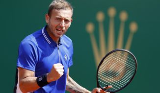Daniel Evans of Britain reacts after scoring a point against David Goffin of Belgium during their quarterfinal match of the Monte Carlo Tennis Masters tournament in Monaco, Friday, April 16, 2021. (AP Photo/Jean-Francois Badias)
