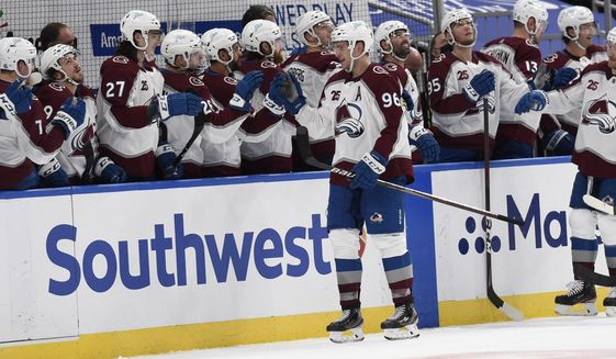 Colorado Avalanche's Mikko Rantanen (96) is congratulated by teammates after scoring a goal against the St. Louis Blues during the second period of an NHL hockey game on Wednesday, April 14, 2021, in St. Louis. (AP Photo/Joe Puetz)