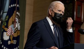 In this Wednesday, April 14, 2021, photo, President Joe Biden removes his mask to speak at a news conference at the White House, in Washington. (AP Photo/Andrew Harnik) **FILE**