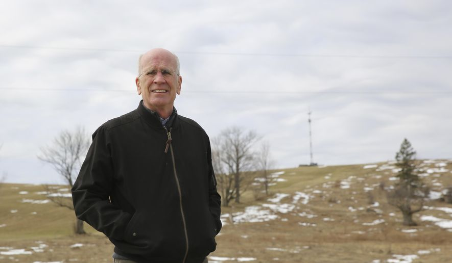 Democratic U.S. Rep. Peter Welch stands for a photograph on a road in Derby Line, Vt., Monday, April 5, 2021. Welch spoke at a news conference about a plan to install surveillance towers along the Vermont border with the Canadian province of Quebec. Behind him is a temporary tower on the spot where a permanent, larger tower would be located. Welch and others say they want to know more about the proposal. U.S Customs and Border Protection say the towers would provide them with more surveillance and detection capabilities along the border. (AP Photo/Wilson Ring)