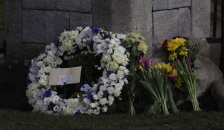 A wreath laid by Andre and Stan Walker for Prince Philip outside Windsor Castle in Windsor, England, Friday, April 16, 2021. Prince Philip husband of Britain's Queen Elizabeth II died April 9, aged 99, his funeral will take place Saturday at Windsor Castle in St George's Chapel. (AP Photo/Alastair Grant)