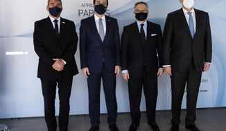 From left to right, Israel foreign minister Gabi Ashkenazi, Cypriot foreign minister Nicos Chrisodoulides, Anwar Gargash of United Arab Emirate and Greek foreign minister Nikos Dendias pose for photo before their meeting of the ministers of foreign affairs of Cyprus, Greece, Israel and United Arab of Emirates in city of Paphos, Cyprus, Friday, April 16, 2021. The event marks the first time the foreign ministers of all four countries have met following the recent normalization of relations between Israel and the United Arab Emirates and aims to expand cooperation to bolster regional stability. (Iakovos Hatzistavrou/Pool via AP)
