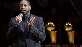 FILE - Former Miami Heat guard Dwyane Wade speaks during a jersey retirement ceremony at halftime of an NBA basketball game between the Heat and the Cleveland Cavaliers in Miami, in this Saturday, Feb. 22, 2020, file photo. Dwyane Wade is an NBA owner. The Utah Jazz announced Friday, April 16, 2021, that the 13-time NBA All-Star will join the youngest ownership group in the league. (AP Photo/Wilfredo Lee, File)