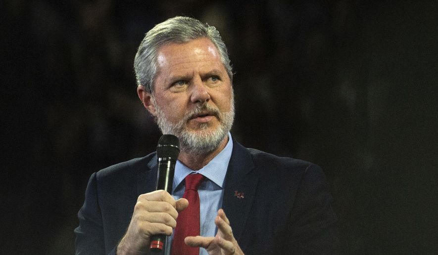 """In this, Nov. 13, 2019, photo, Liberty University President Jerry Falwell Jr. talks to Donald Trump Jr. about his new book """"Triggered"""" during convocation at Liberty University in Lynchburg, Va.  Liberty University has filed a civil lawsuit against its former leader, Jerry Falwell Jr., seeking millions in damages after the two parted ways acrimoniously last year. The Associated Press obtained the complaint, which was filed Thursday, April 15, 2021, in Lynchburg Circuit Court. (Emily Elconin/The News & Advance via AP) **FILE**"""