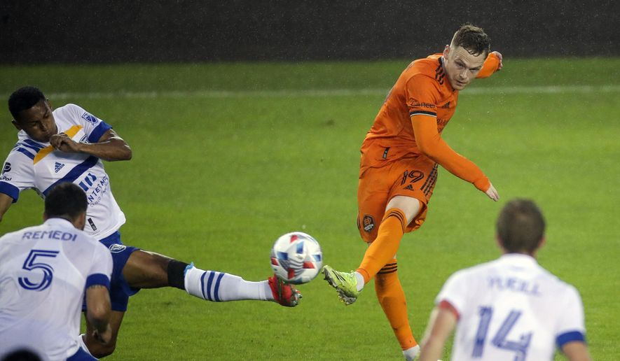 Houston Dynamo FC forward Tyler Pasher (19) shoots the ball against the San Jose Earthquakes during the first half of an MLS soccer game at BBVA Stadium on Friday, April 16, 2021, in Houston. (Godofredo A. Vásquez/Houston Chronicle via AP)