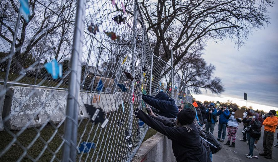 People protest near the Brooklyn Center Police Department on Thursday, April 15, 2021, in Brooklyn Center, Minn., over the fatal shooting of Daunte Wright, a 20-year-old Black man, during a traffic stop. (Richard Tsong-Taatarii/Star Tribune via AP)