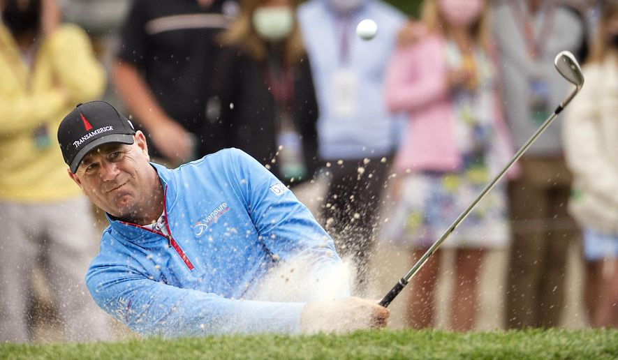 Stewart Cink hits out of the bunker on the 15th hole during the second round of the RBC Heritage golf tournament in Hilton Head Island, S.C., Friday, April 16, 2021. (AP Photo/Stephen B. Morton)