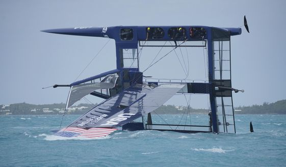 In this Friday, April 16 2021, photo provided by SailGP, Australia's SailGP team capsizes while on United States' wing-sailed F50 foiling catamaran on Bermuda's Great Sound while practicing for the season opener. No injuries were sustained, according to SailGP. (Ugo Fonolla/SailGP via AP)