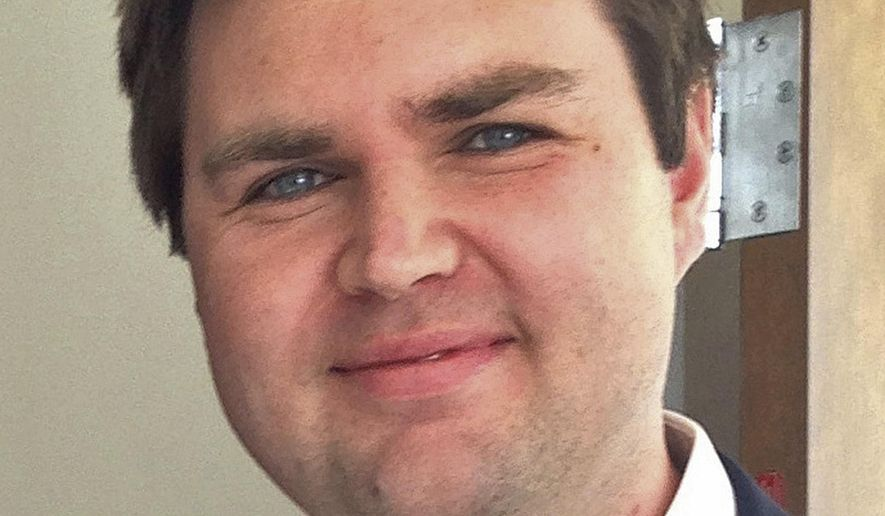 """In this Nov. 16, 2016, file photo, J.D. Vance, author of the best-selling memoir """"Hillbilly Elegy,"""" poses for a photograph at Miami University's student center in Oxford, Ohio. Vance, whose book helped explain to the nation Donald Trump's popularity among the Appalachian working class, is """"thinking seriously"""" about running for the U.S. Senate seat Republican two-term incumbent Rob Portman decided against seeking again in 2022. (AP Photo/Dan Sewell, File)"""
