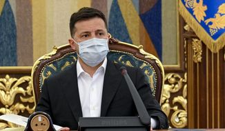 In this photo released by Ukrainian Presidential Press Office, Ukrainian President Volodymyr Zelenskyy leads a meeting of the National Security and Defense Council in Kyiv, Ukraine, Thursday, April 15, 2021. Ukraine's President Volodymyr Zelensky is heading Friday to Paris to discuss the tensions with French President Emmanuel Macron. (Ukrainian Presidential Press Office via AP)