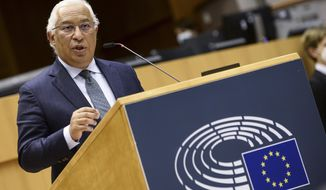 FILE - In this Wednesday, March 10, 2021 file photo, Portugal's Prime Minister Antonio Costa addresses European lawmakers at the European Parliament in Brussels. While most of the Europe Union grapples with new surges of COVID-19 cases and brings back curbs on what people can do, Portugal is going in the other direction. From next Monday, the Portuguese will be able to go back to restaurants, shopping malls and cinemas. Prime Minister Antonio Costa warned late Thursday, April 15, 2021 that the country could reverse gear and go back into lockdown if cases start to rise again. (Johanna Geron, Pool Photo via AP, file)