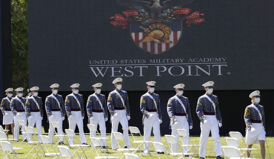 FILE - In this June 13, 2020, file photo, United States Military Academy graduating cadets, wearing face masks, march to their socially-distanced seating during commencement ceremonies in West Point, N.Y. Most of the 73 West Point cadets accused in the biggest cheating scandal in decades at the U.S. Military Academy are being required to repeat a year, and eight were expelled, academy officials said Friday, April 16, 2021. (AP Photo/John Minchillo, Pool, File) (AP Photo/John Minchillo, Pool, File)