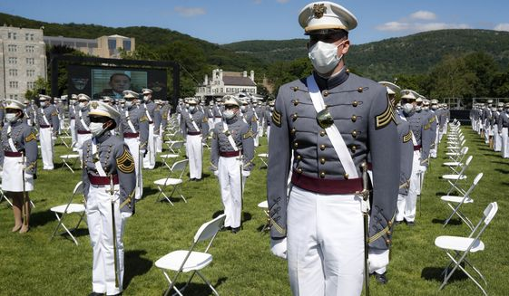In this June 13, 2020, file photo, United States Military Academy graduating cadets wear face masks as they stand next to their socially distanced seats during commencement ceremonies in West Point, N.Y. (AP Photo/John Minchillo, Pool) **FILE**