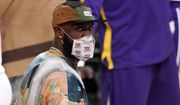 Los Angeles Lakers' LeBron James looks on from the bench during the second half of an NBA basketball game against the Utah Jazz Saturday, April 17, 2021, in Los Angeles. (AP Photo/Mark J. Terrill)