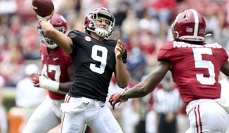 White team quarterback Bryce Young (9) throws over Crimson team defensive back Jalyn Armour-Davis (5) during Alabama's spring NCAA college football game at Bryant-Denny Stadium, Saturday, April 17, 2021, in Tuscaloosa, Ala. (Gary Cosby/The Tuscaloosa News via AP)
