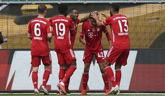 Bayern's Jamal Musiala, second right, celebrates after scoring his side's third goal during the German Bundesliga soccer match between VfL Wolfsburg and FC Bayern Munich in Wolfsburg, Germany, Saturday, April 17, 2021. (AP Photo/Michael Sohn)