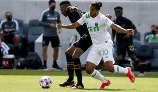 Austin FC midfielder Cecilio Dominguez (10) and Los Angeles FC midfielder Mark-Anthony Kaye vie for the ball during the first half of an MLS soccer match Saturday, April 17, 2021, in Los Angeles. (AP Photo/Ringo H.W. Chiu)