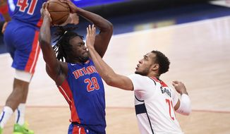 Detroit Pistons center Isaiah Stewart (28) keeps the ball away from Washington Wizards center Daniel Gafford (21) during the first half of an NBA basketball game, Saturday, April 17, 2021, in Washington. (AP Photo/Nick Wass)