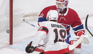 Ottawa Senators' Drake Batherson (19) scores against Montreal Canadiens goaltender Carey Price during second-period NHL hockey game action in Montreal, Saturday, April 17, 2021. (Graham Hughes/The Canadian Press via AP)