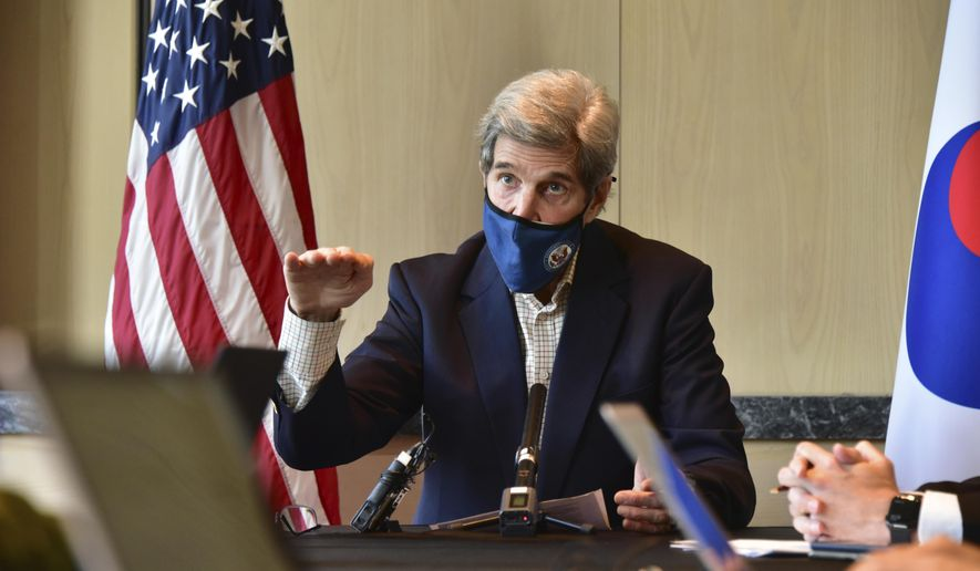 In this photo provided by U.S. Embassy Seoul, U.S. special envoy for climate John Kerry gestures while  speaking during a round table meeting with the media in Seoul, South Korea, Sunday, April 18, 2021. The United States and China, the world's two biggest carbon polluters, have agreed to cooperate with other countries to curb climate change, just days before U.S. President Joe Biden hosts a virtual summit of world leaders to discuss the issue. (U.S. Embassy Seoul via AP)