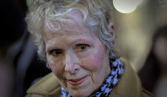 """FILE - In this March 4, 2020 file photo, E. Jean Carroll talks to reporters outside a courthouse in New York.  Lawyers for Carroll, who is suing former President Donald Trump, say the U.S. Justice Department made a """"wrong and dangerous"""" argument in seeking to defend him.  E. Jean Carroll's lawyers wrote that in court papers filed late Friday, April 16, 2021 (AP Photo/Seth Wenig, File)"""
