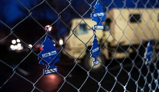 Air fresheners for cars hang from a perimeter fence outside the Brooklyn Center Police Department in Minnesota to protest the shooting death of Daunte Wright, a Black man who was pulled over for the offense. (Associated Press)