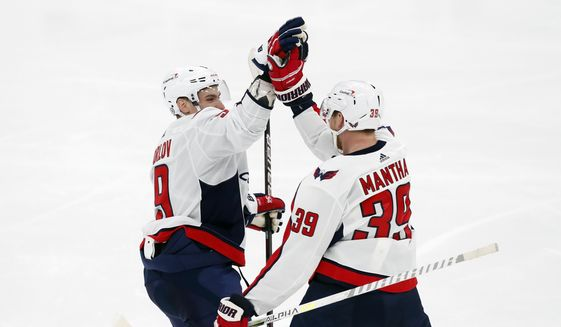 Washington Capitals' Zach Fucale (39) celebrates his goal with Dmitry Orlov (9) during the second period of an NHL hockey game against the Boston Bruins, Sunday, April 18, 2021, in Boston. (AP Photo/Michael Dwyer) **FILE**