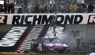 Alex Bowman (48) stands on his car as he celebrates after winning a NASCAR Cup Series auto race at Richmond International Raceway in Richmond, Va., Sunday, April 18, 2021. (AP Photo/Steve Helber)