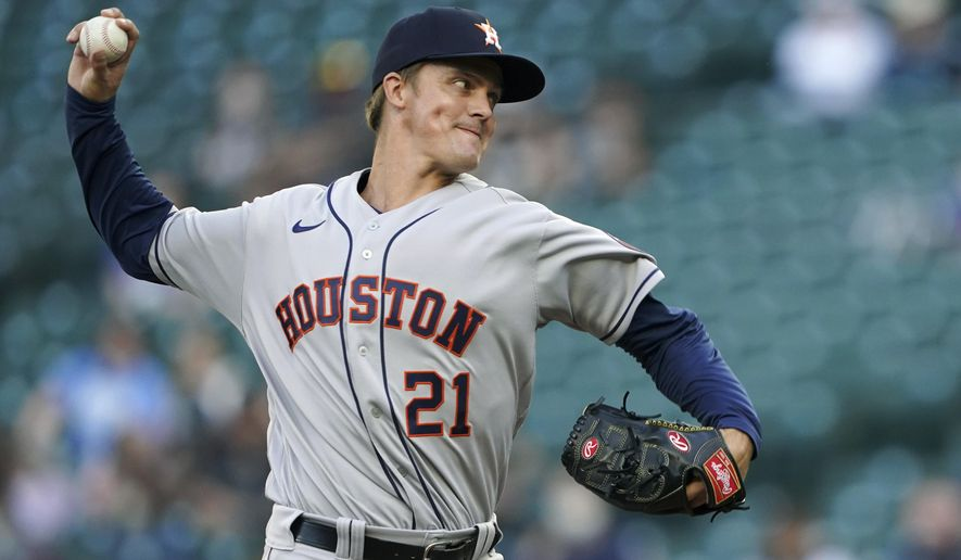 Houston Astros starting pitcher Zack Greinke throws to a Seattle Mariners batter during the first inning of a baseball game Saturday, April 17, 2021, in Seattle. (AP Photo/Ted S. Warren)